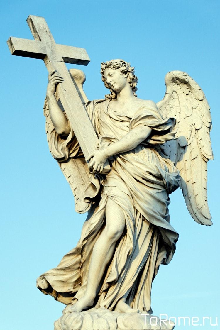 Скульптура ангела с крестом на мосту Святого Ангела